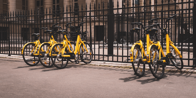 Sharing economy: Yellow bikes parked in a row