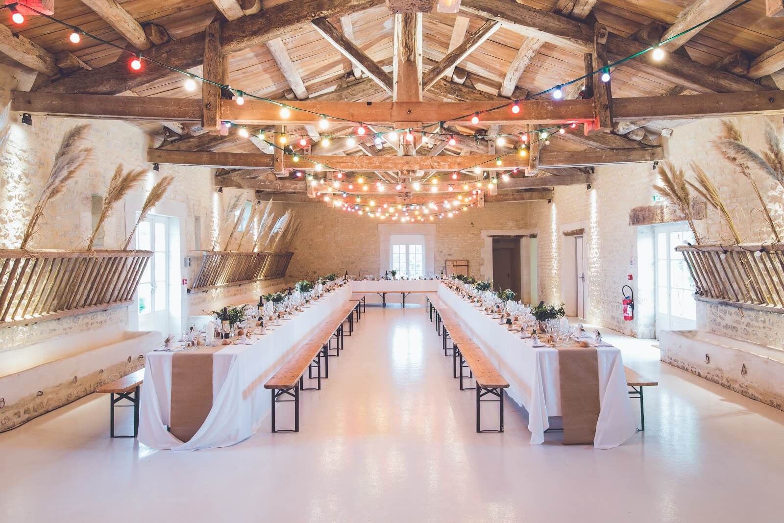 How to become a wedding planner: Two long banquet tables in event space