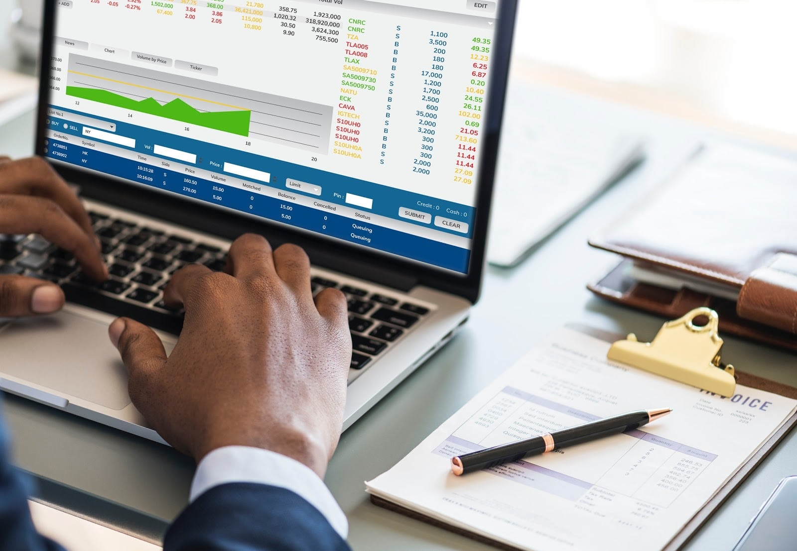 What is accrual accounting: Hands type on laptop with charts and figures on the screen