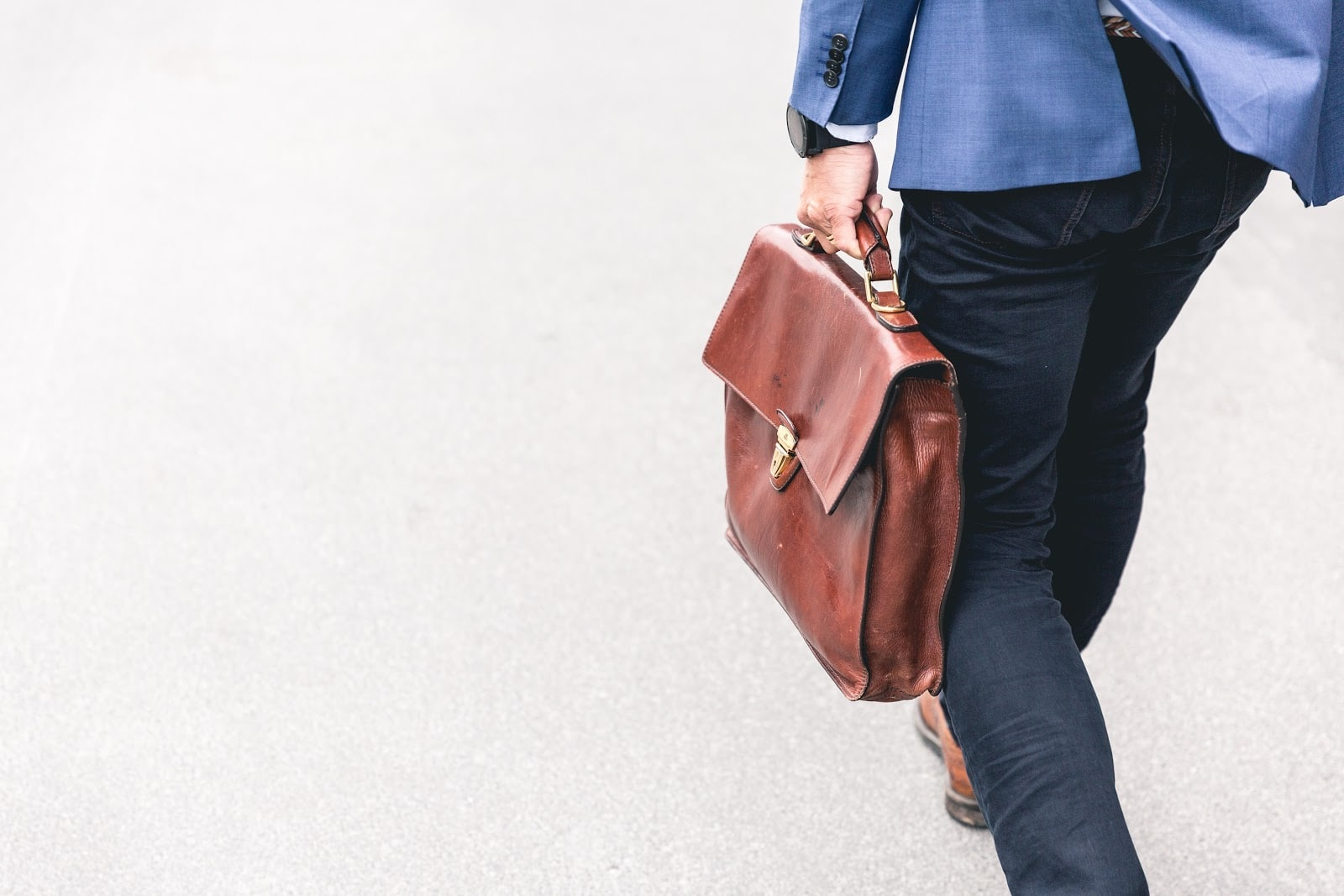 what is business administration: man walking with leather brief case
